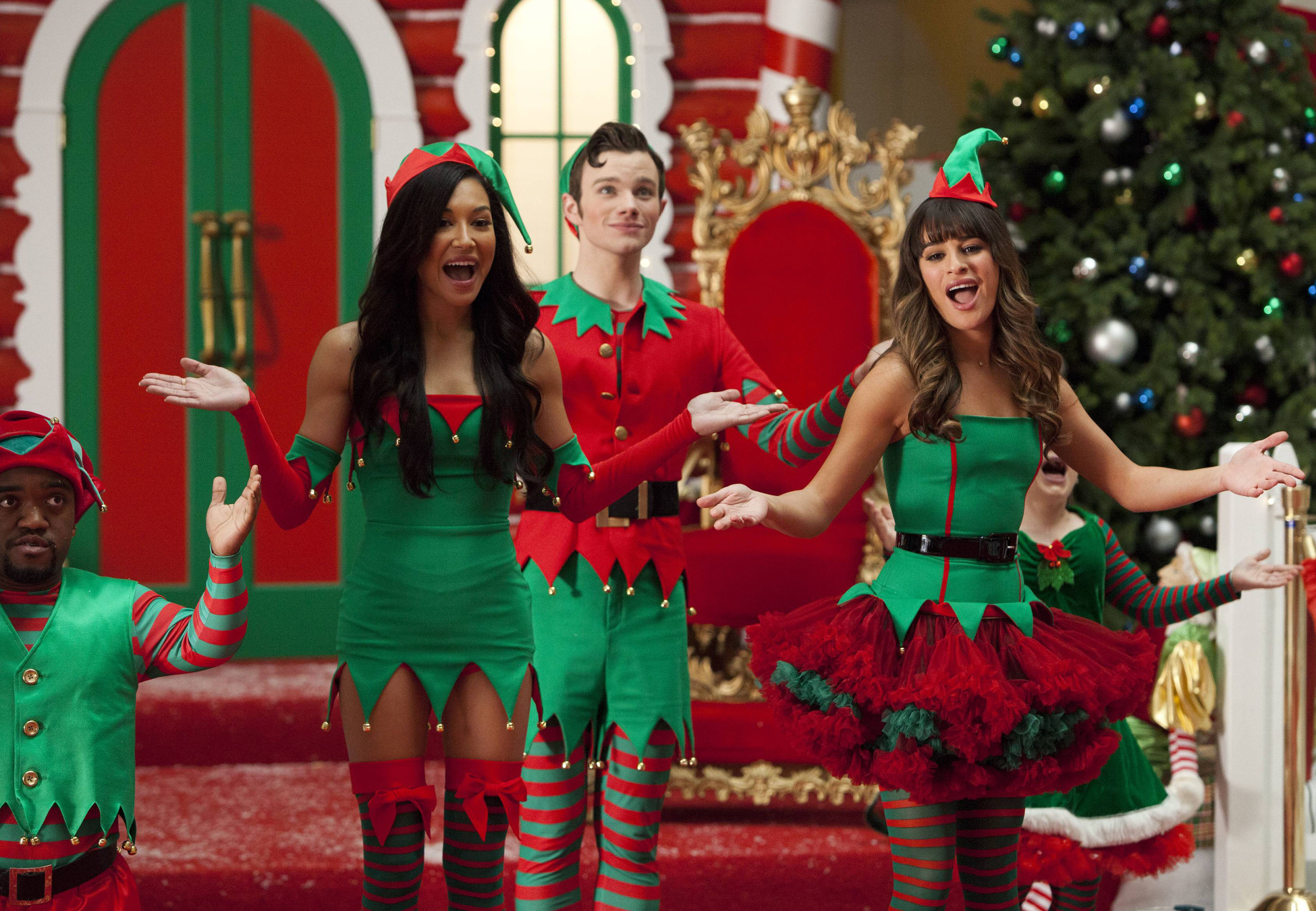 "GLEE: Santana (Naya Rivera, L), Kurt (Chris Colfer, C) and Rachel (Lea Michele, R) work as Santa's elves at a mall in the ""Previously Unaired Christmas"" Fall Finale episode of GLEE airing Thursday, Dec. 5 (9:00-10:00 PM ET/PT) on FOX. ©2013 Fox Broadcasting Co. CR: Adam Rose/FOX"